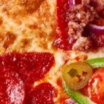 New York Pizza verkoopt donuts van Dunkin' Donuts en pizza van 40 cm