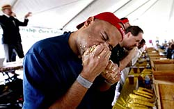Yasir Salem of New York finishes off an ear of corn.
