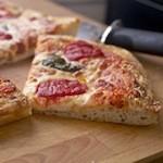 Het essentiële verschil tussen ronde en vierkante pizza's