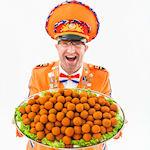 Oranje bitterballen op schaal
