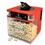 Popcornmachine schiet popcorn naar gebruiker